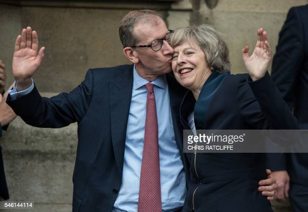 Britain's new Conservative Party leader Theresa May receives a kiss from her husband Philip John May after speaking to members of the media at The St...