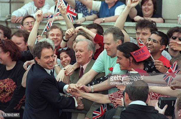 Britain's new Prime Minister and Labour leader Tony Blair is greeted by supporters outside 10 Downing Street when he arrives 02 May 1997 after...