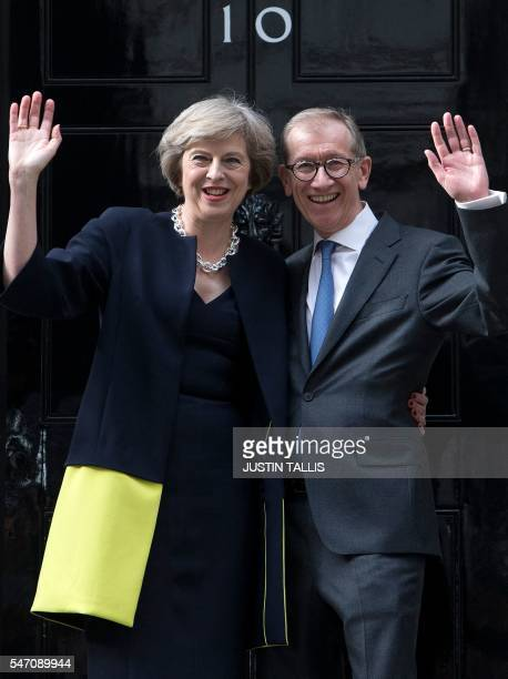 Britain's new Prime Minister Theresa May and her husband Philip John wave outside 10 Downing Street in central London on July 13 2016 on the day she...