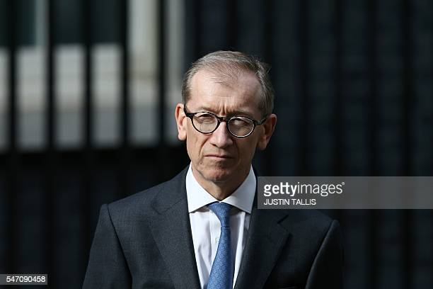 Britain's new Prime Minister Theresa May speaks outside 10 Downing Street as her husband Philip John listens in central London on July 13 2016 on the...