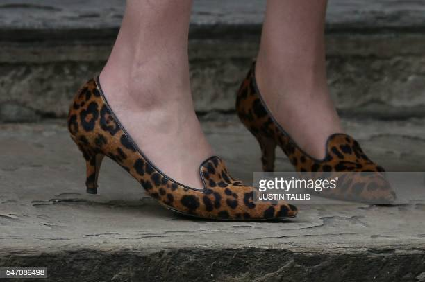 Britain's new Prime Minister Theresa May's Leopardprint shoes are pictured outside the door of 10 Downing Street in central London on July 13 2016 on...