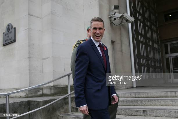 Britain's newly appointed Defence Secretary Gavin Williamson turns to the media as he is greeted outside the Ministry of Defence in central London on...