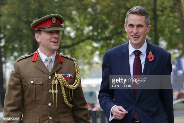 Britain's newly appointed Defence Secretary Gavin Williamson walks with Military Adviser Colonel John Clark outside the Ministry of Defence in...