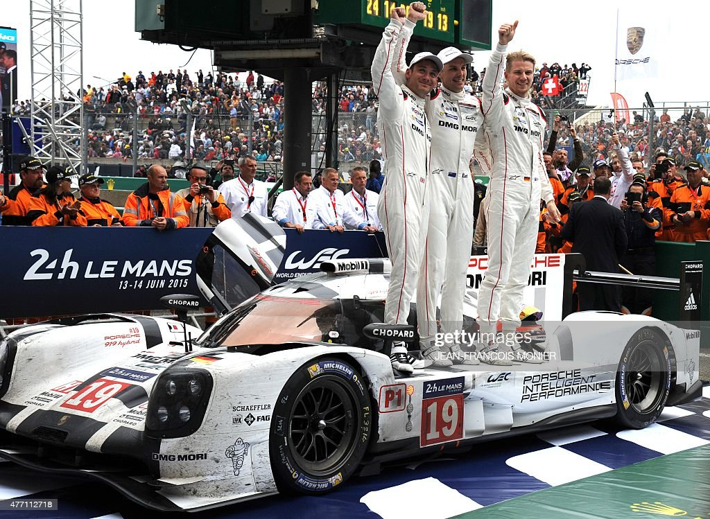 Britain's Nick Tandy New Zealand's Earl Bamber and Germany's Nico Hulkenberg celebrate their victory on their Porsche 919 Hybrid N°19 after winning...