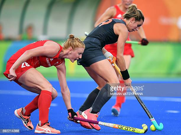Britain's Nicola White vies with Netherlands' Ellen Hoog during the women's Gold medal hockey Netherlands vs Britain match of the Rio 2016 Olympics...