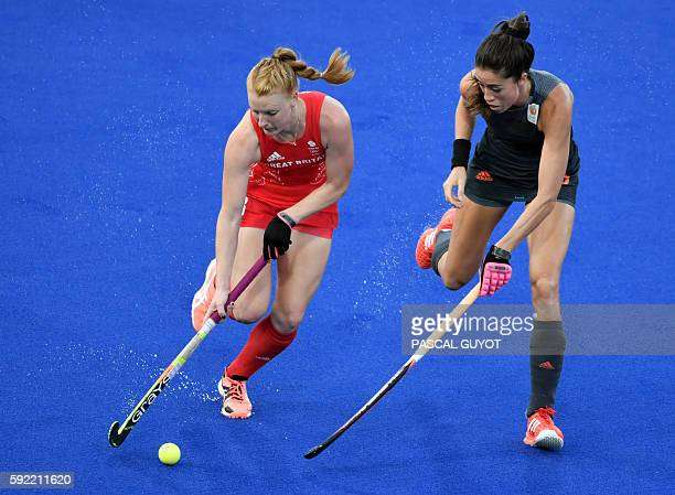 Britain's Nicola White vies with Netherlands' Naomi van As during the women's Gold medal hockey Netherlands vs Britain match of the Rio 2016 Olympics...