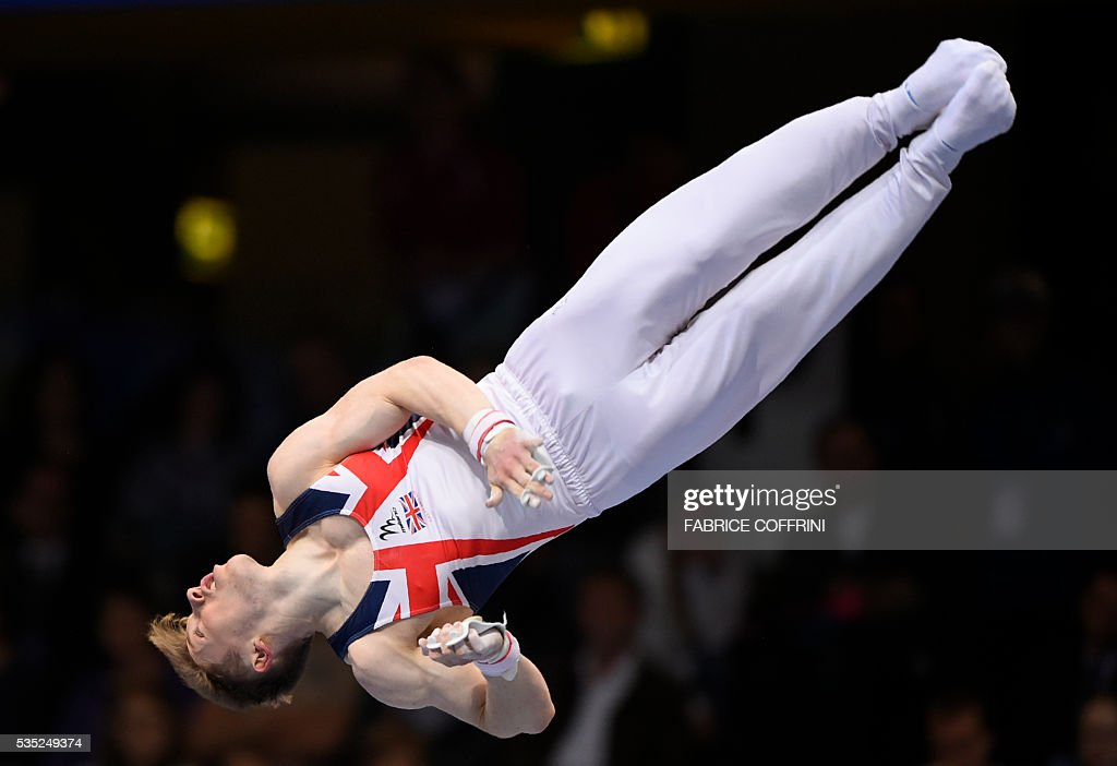 Britains Nile Wilson performs during the Mens Horizontal Bar competition of the European Artistic Gymnastics Championships 2016 in Bern, Switzerland on May 29, 2016. / AFP / FABRICE