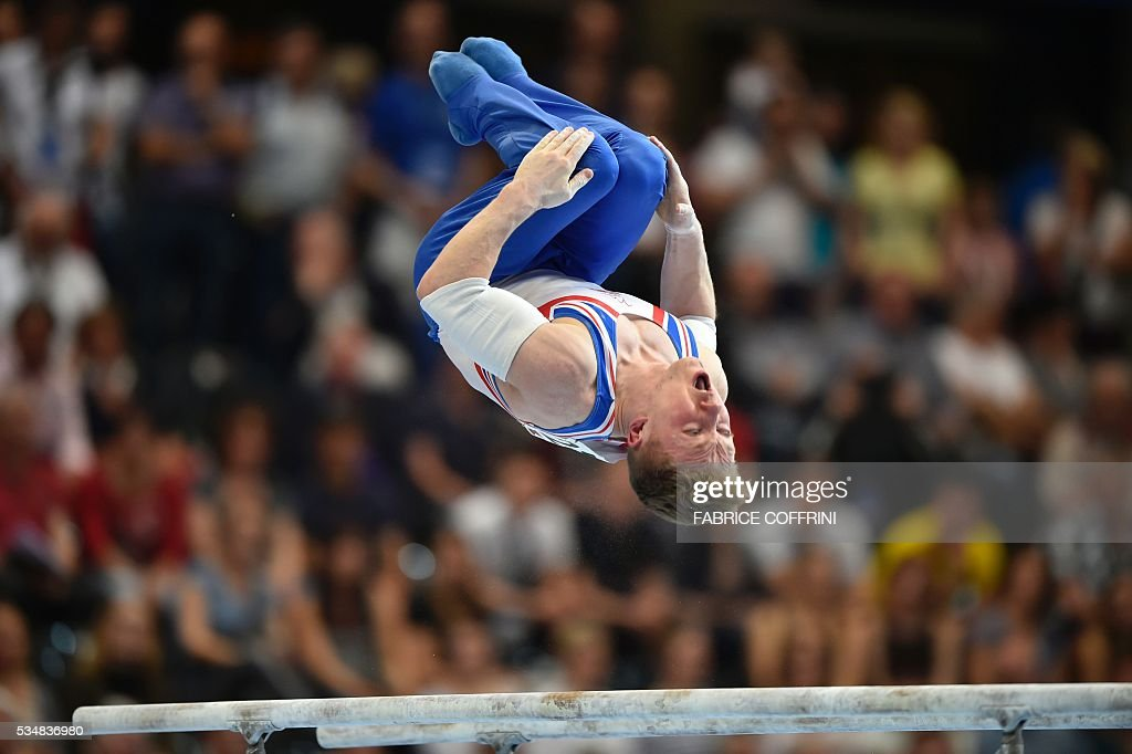 Britain's Nile Wilson performs during the Mens Parallel Bars competition of the European Artistic Gymnastics Championships 2016 in Bern, Switzerland on May 28, 2016. / AFP / FABRICE