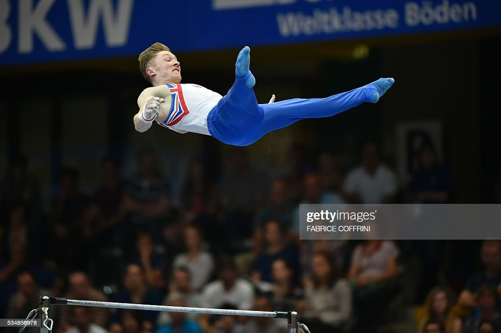 Britain's Nile Wilson performs in the Mens Horizontal Bar competition of the European Artistic Gymnastics Championships 2016 in Bern, Switzerland on May 28, 2016. / AFP / FABRICE