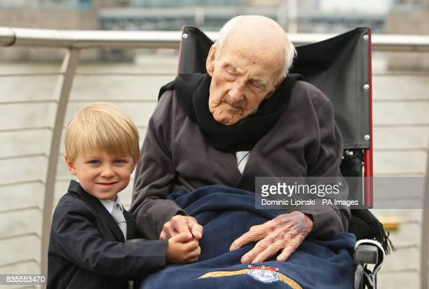 Britain's oldest man and oldest surviving First World War veteran Henry Allingham celebrates his 113th birthday with his great great grandson Erik...