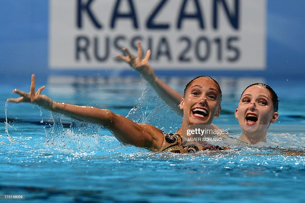 Britain's Olivia Federici and Jenna Randall compete in the duet technique preliminary round during the synchronised swimming competition in the FINA World Championships at the Palau Sant Jordi in Barcelona, on July 21, 2013.