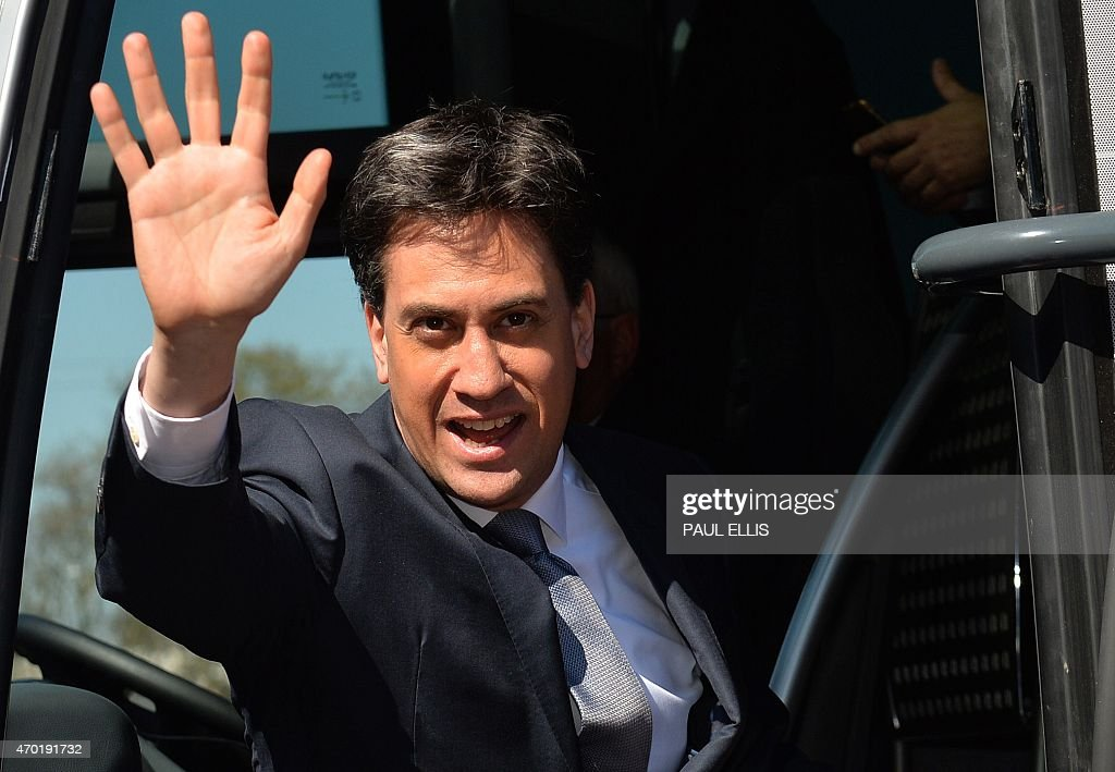 Britain's Opposition Labour leader <a gi-track='captionPersonalityLinkClicked' href=/galleries/search?phrase=Ed+Miliband&family=editorial&specificpeople=4376337 ng-click='$event.stopPropagation()'>Ed Miliband</a> waves as he boards his campaign election bus after delivering a speech at Pensby High School in Pensby, north-west Engand on April 18, 2015. Britain goes to the polls on May 7 to elect a new Prime Minister.