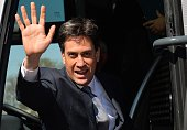Britain's Opposition Labour leader Ed Miliband waves as he boards his campaign election bus after delivering a speech at Pensby High School in Pensby...