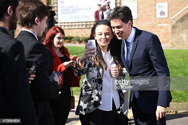 Britain's Opposition Labour Party Leader Ed Miliband poses for a selfie with a female supporter before launching his party's Manifesto for Young...