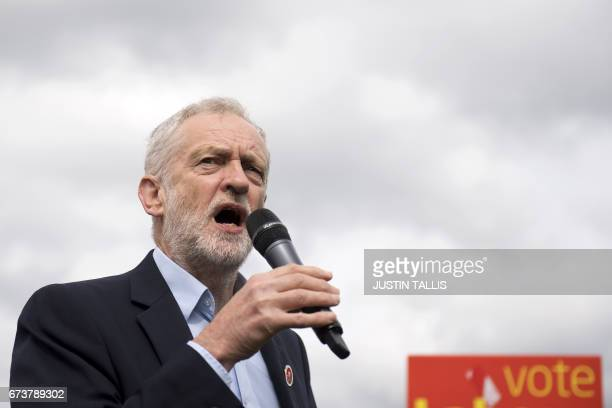 Britain's opposition Labour Party Leader Jeremy Corbyn addresses supporters during a campaign meeting in Harlow Town Park Essex north of London on...