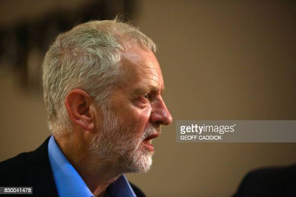 Britain's opposition Labour party leader Jeremy Corbyn addresses a members' meeting as part of his summer campaign tour in Bristol on August 11 2017...