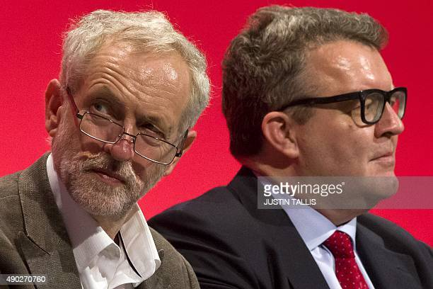 Britain's opposition Labour Party leader Jeremy Corbyn and deputy leader Tom Watson sit on stage during the annual Labour Party conference in...