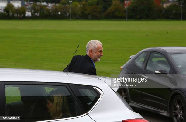Britain's opposition Labour party leader Jeremy Corbyn arrives for a members' meeting as part of his summer campaign tour in Bristol on August 11...