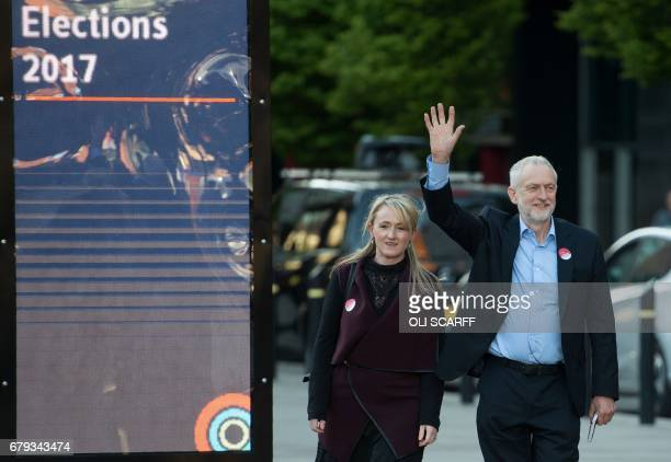 Britain's opposition Labour Party Leader Jeremy Corbyn arrives with Labour politician Rebecca Long Bailey to address supporters in Manchester in...