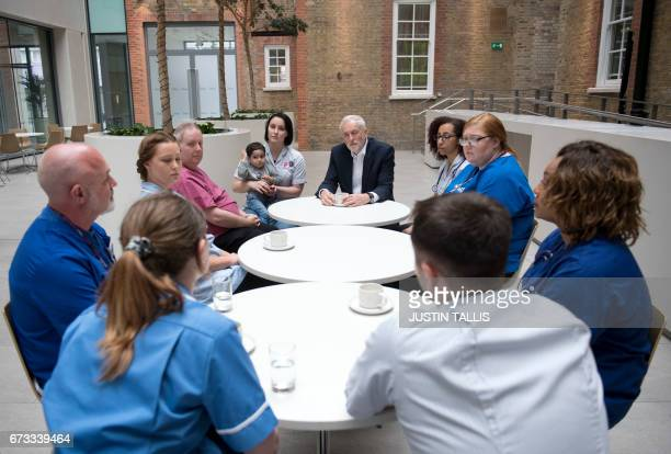 Britain's opposition Labour Party leader Jeremy Corbyn attends a round table discussion with nurses other medical staff and students and Haroon...