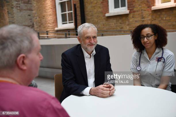 Britain's opposition Labour Party leader Jeremy Corbyn attends a round table discussion with nurses other medical staff and students during a general...