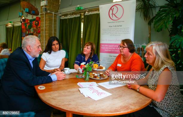 Britain's opposition Labour Party Leader Jeremy Corbyn enjoys a cup of tea and cake on a visit to the Manor Garden Centre in Swindon west of London...