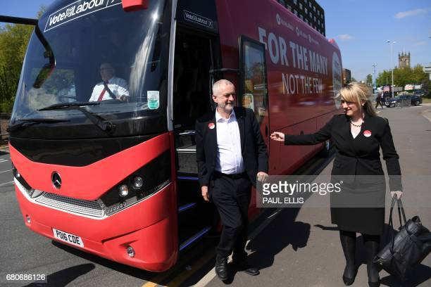Britain's opposition Labour party Leader Jeremy Corbyn is greeted by Labour MP for Salford and Eccles Rebecca LongBailey as he steps of the campaign...