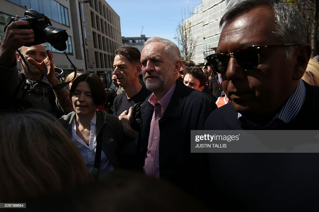 Britain's opposition Labour Party leader Jeremy Corbyn (C) leaves after giving a speech at a May Day rally in London on May 1, 2016. / AFP / JUSTIN
