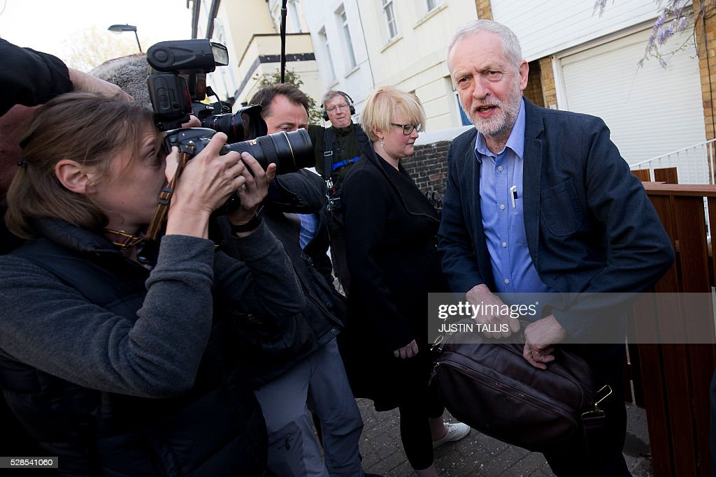 Britain's opposition Labour Party leader Jeremy Corbyn (R) leaves his home in London on May 6, 2016. Early results Friday from British local and regional elections seen as a key test for opposition Labour leader Jeremy Corbyn showed strong gains for Scottish nationalists, as London looked set to elect its first Muslim mayor. / AFP / JUSTIN