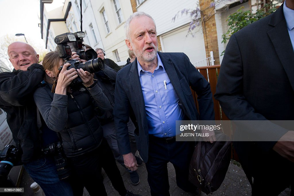 Britain's opposition Labour Party leader Jeremy Corbyn (C) leaves his home in London on May 6, 2016. Early results Friday from British local and regional elections seen as a key test for opposition Labour leader Jeremy Corbyn showed strong gains for Scottish nationalists, as London looked set to elect its first Muslim mayor. / AFP / JUSTIN