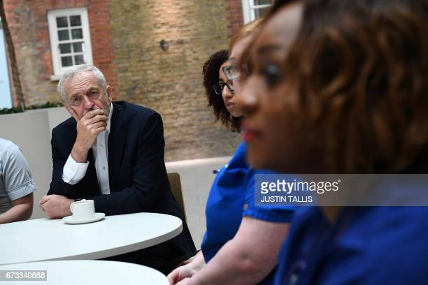Britain's opposition Labour Party leader Jeremy Corbyn listens at a round table discussion with nurses other medical staff and students during a...