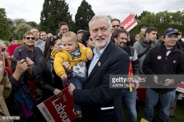 Britain's opposition Labour Party Leader Jeremy Corbyn poses with yearold Angelo after speaking at a campaign event in Harlow Town Park Essex north...