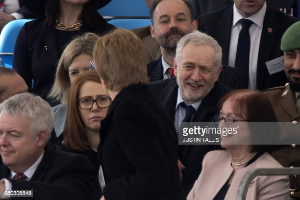 Britain's opposition Labour Party Leader Jeremy Corbyn speaks to SNP leader Nicola Sturgeon as they attend a Service of Commemoration and Drumhead...