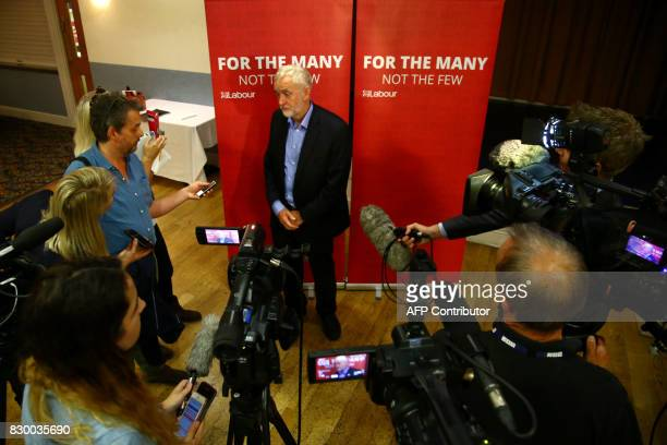 Britain's opposition Labour party leader Jeremy Corbyn speaks to the media at a members' meeting as part of his summer campaign tour in Bristol on...