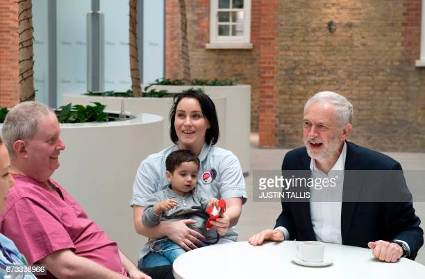 Britain's opposition Labour Party leader Jeremy Corbyn talks during a round table discussion with nurses other medical staff and students and Haroon...