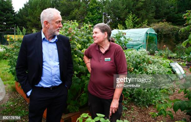 Britain's opposition Labour Party Leader Jeremy Corbyn talks to Steph Perry in the kitchen garden of the Manor Garden Centre in Swindon west of...