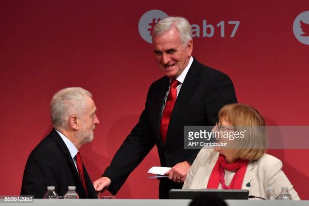 Britain's opposition Labour party's Shadow Chancellor of the Exchequer John McDonnell speaks with Labour party's leader Jeremy Corbyn ahead of making...