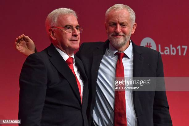 Britain's opposition Labour party's Shadow Chancellor of the Exchequer John McDonnell is congratulated by Labour party's leader Jeremy Corbyn after...