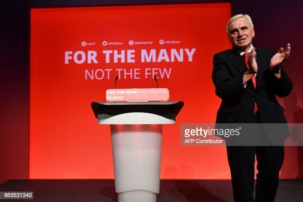 Britain's opposition Labour party's Shadow Chancellor of the Exchequer John McDonnell applauds after making a speech on the second day of the Labour...