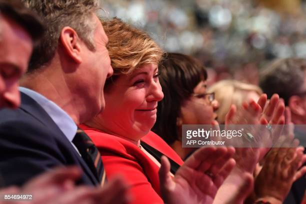 Britain's opposition Labour party's Shadow Foreign Secretary Emily Thornberry applauds as Britain's main opposition Labour party leader Jeremy Corbyn...