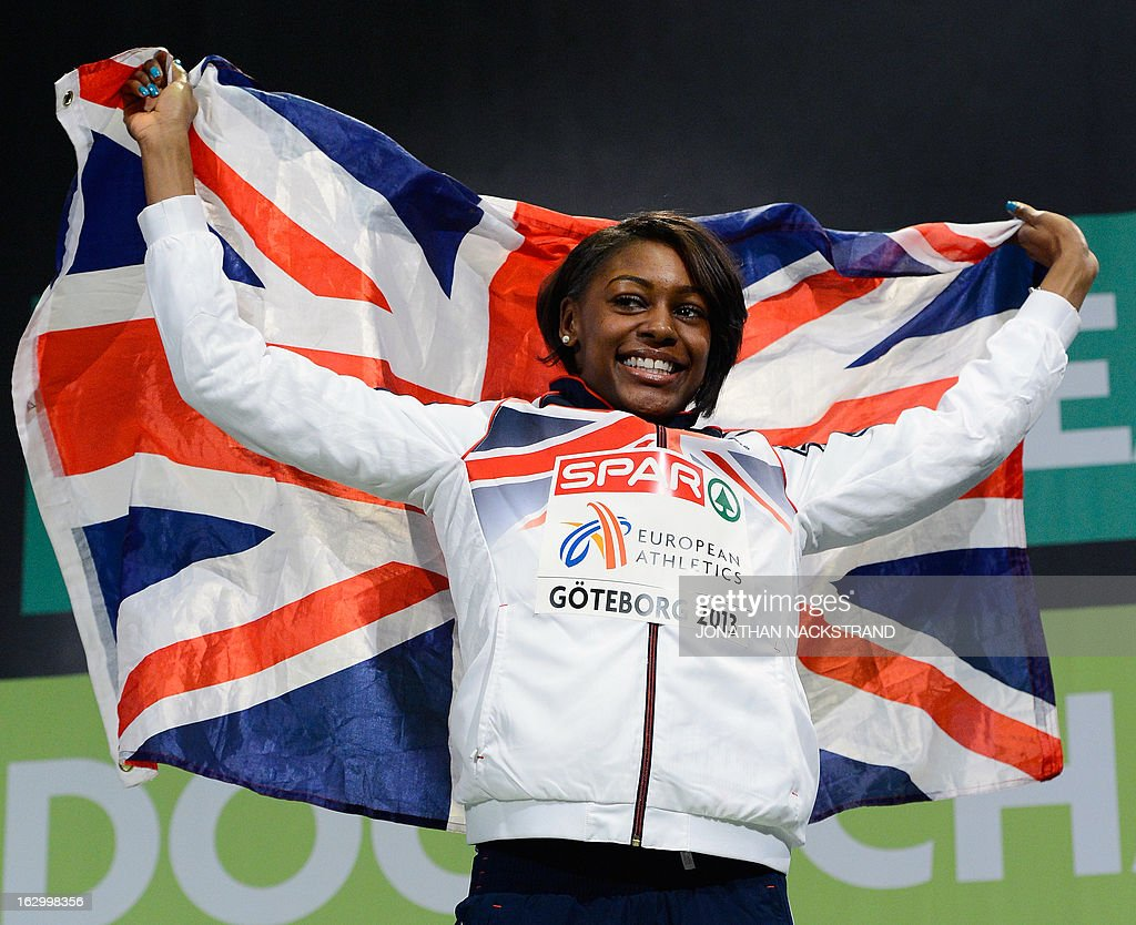 Britain's Perri Shakes-Drayton celebrates winning the women's 400m final on the podium at the European Indoor athletics Championships in Gothenburg, Sweden, on March 3, 2013.