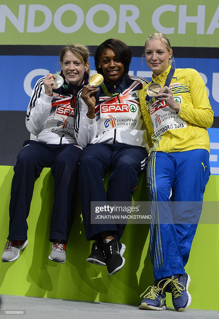 Britain's Perri Shakes-Drayton (C) celebrates winning the women's 400m final on the podium with 2nd place Britain's Eilidh Child (L) and 3rd place Sweden's Moa Hjelmer at the European Indoor athletics Championships in Gothenburg, Sweden, on March 3, 2013.