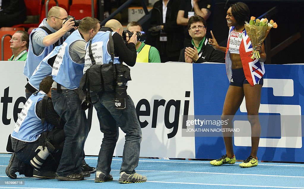 Britain's Perri Shakes-Drayton (R) is photographed as she celebrates winning the women's 400m final at the European Indoor athletics Championships in Gothenburg, Sweden, on March 3, 2013. AFP PHOTO / JONATHAN NACKSTRAND