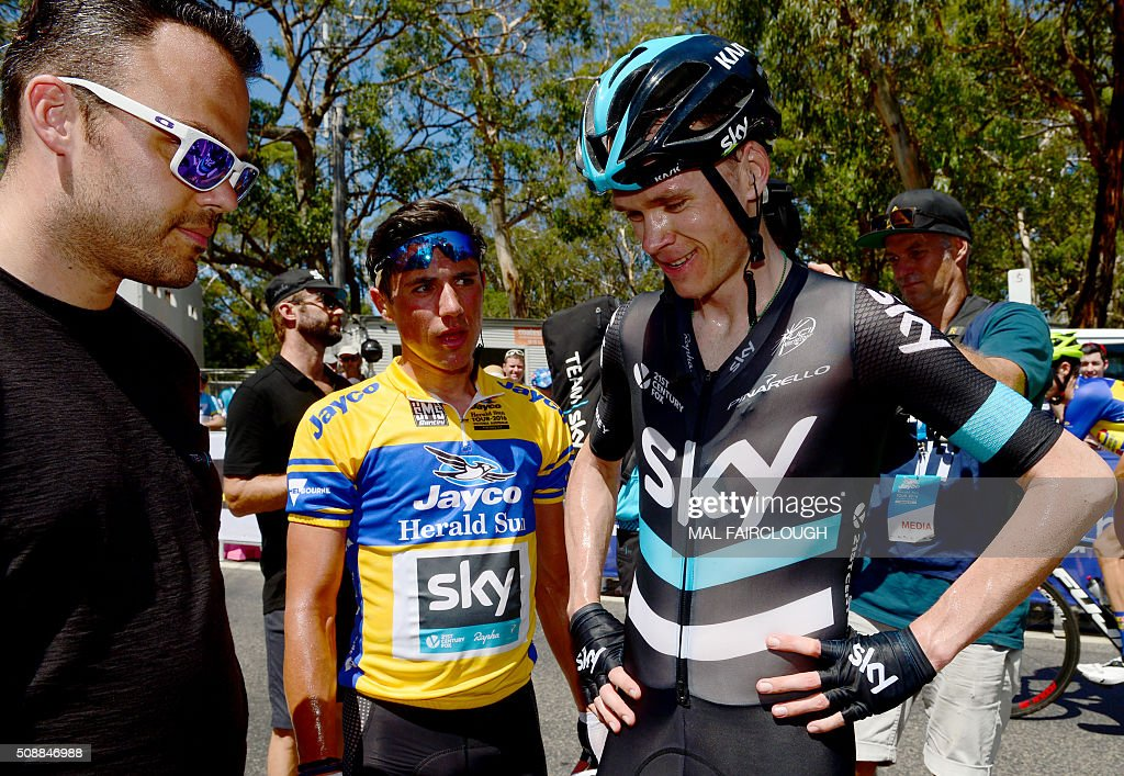Britain's Peter Kennaugh (C) and Chris Froome of Team Sky (R) chat after finishing stage four of the 2016 Herald Sun Tour cycling race at Arthurs Seat in Victoria on February 7, 2016. AFP PHOTO / MAL FAIRCLOUGH FAIRCLOUGH