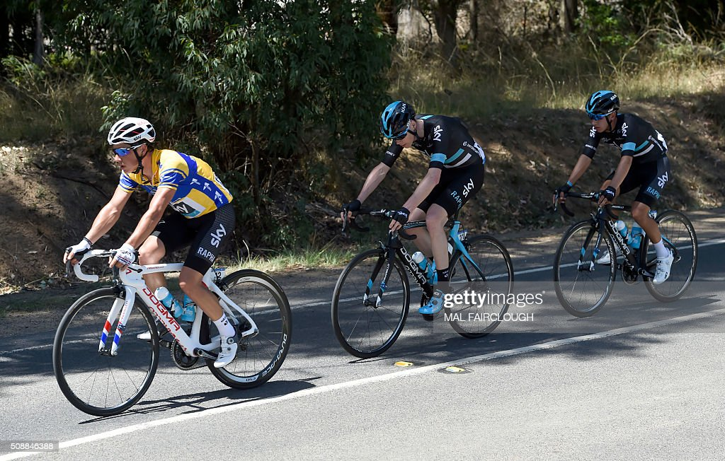 Britain's Peter Kennaugh (L) leads Team Sky teammates Chris Froome of Britain (C) and Sebastian Henao Gomez (R) of Colombia during stage four of the 2016 Herald Sun Tour cycling race at Arthurs Seat in Victoria on February 7, 2016. AFP PHOTO / MAL FAIRCLOUGH FAIRCLOUGH