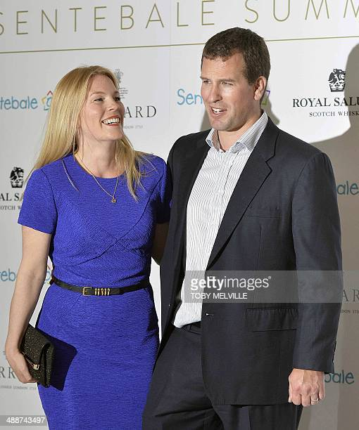 Britain's Peter Phillips and his wife Autumn pose for pictures upon arrival to attend the 'Sentebale Summer Party' in London on May 7 2014 The prince...