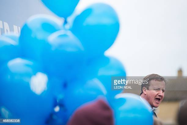 Britain's Prime Minister and Conservative party leader David Cameron talks to supporters at Abingdon and Witney College in Abingdon southern England...