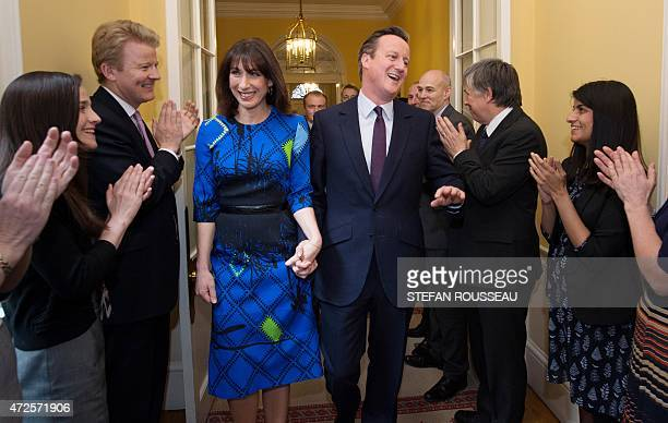 Britain's Prime Minister and Leader of the Conservative Party David Cameron and his wife Samantha are applauded by staff upon entering 10 Downing...