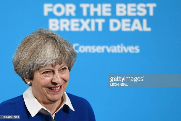 TOPSHOT Britain's Prime Minister and Leader of the Conservative party Theresa May delivers a general election campaign speech in Wolverhampton...