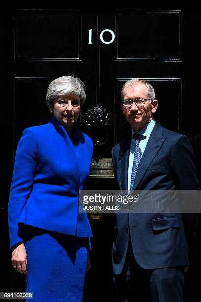 Britain's Prime Minister and leader of the Conservative Party Theresa May accompanied by her husband Philip pose after the prime minister delivered a...